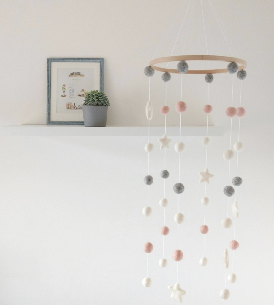 Felt ball mobile for crib and nursery in pastel colors