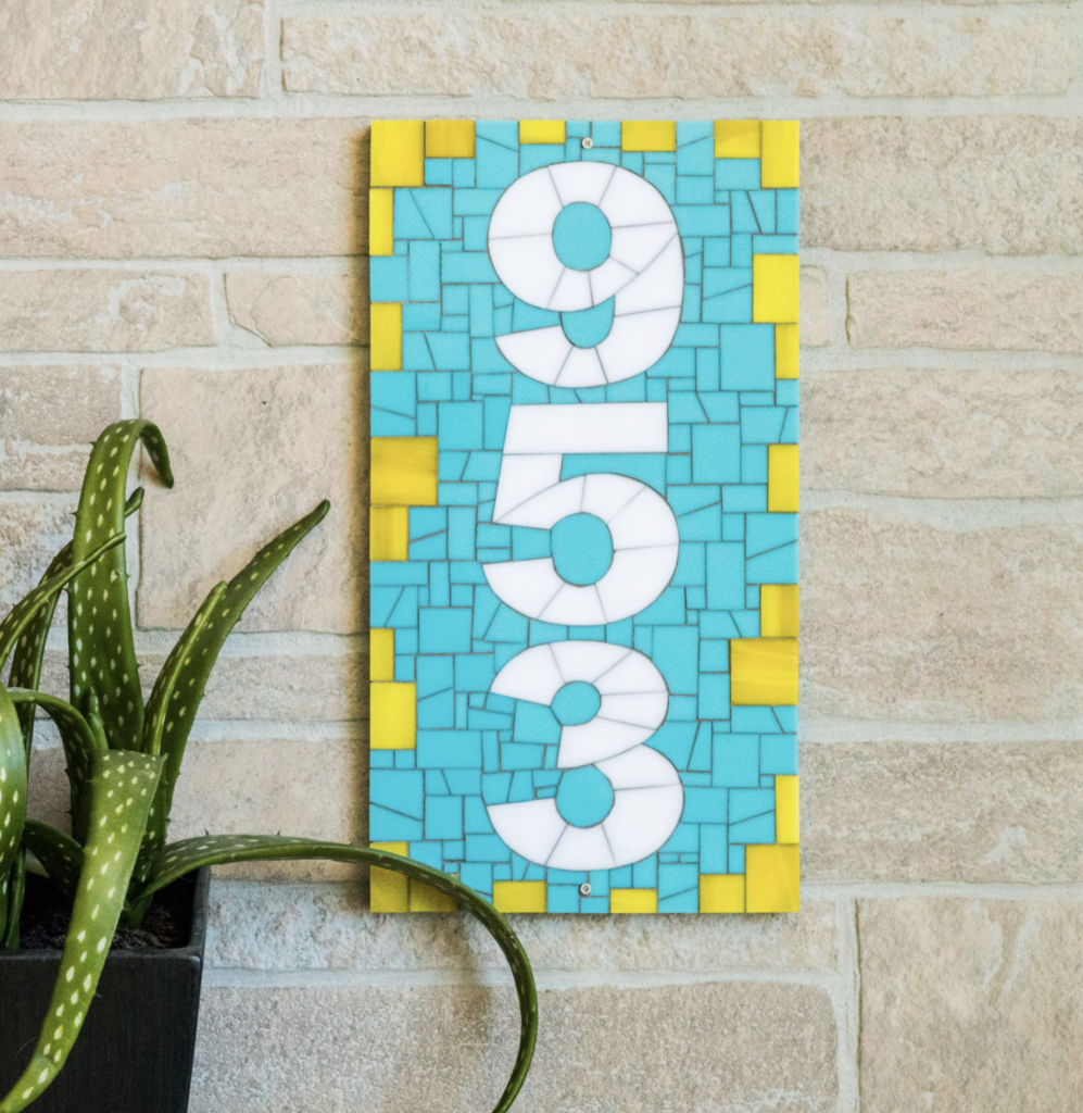 House number plaque in mosaic tile