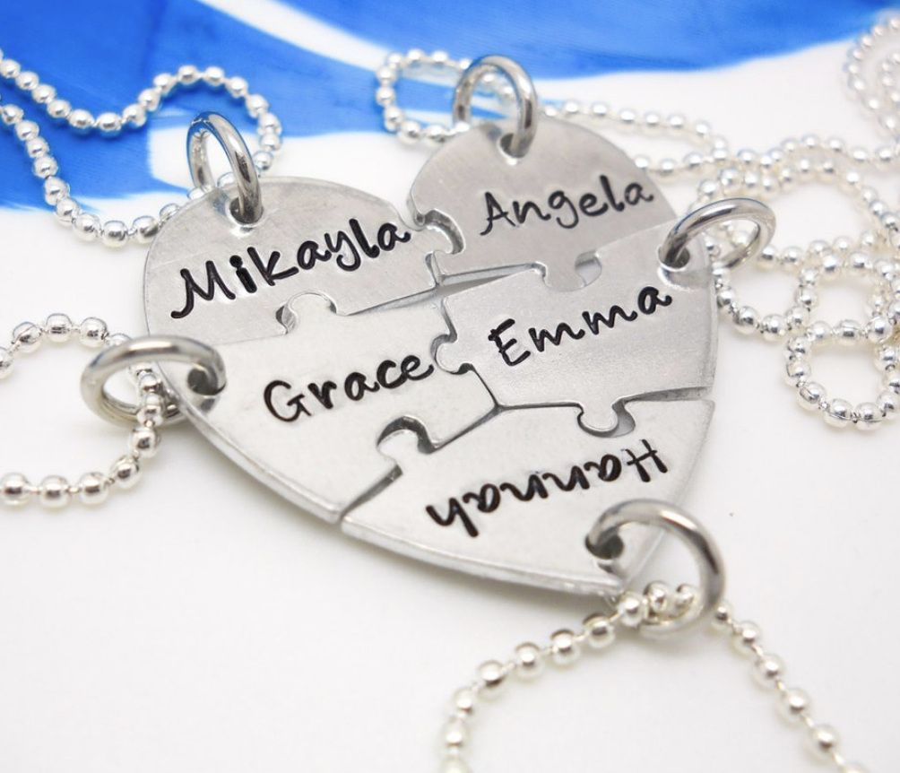 puzzle piece necklace engraved with names
